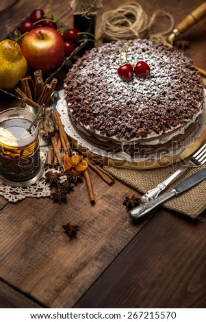 Homemade chocolate pie on vintage wooden background