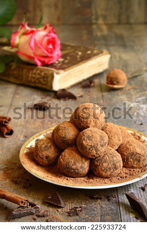 Homemade chocolate truffles on a plate, - stock photo
