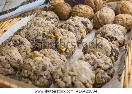 homemade chocolate walnut cookies with ingredients and kitchen u