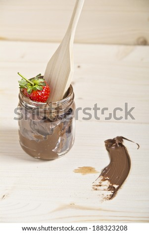 homemade chocolate with strawberry on wood - stock photo