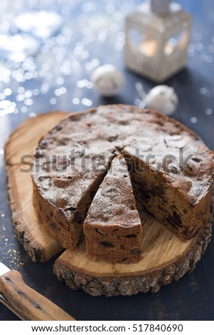 Homemade Christmas cake on blue table