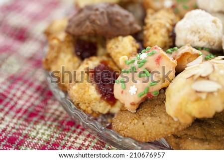 Homemade Christmas Cookies arranged on a plate. Shallow depth of field.