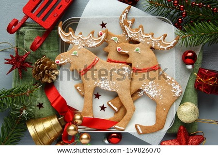 Homemade christmas cookies with christmas decoration. Elk shapes. - stock photo