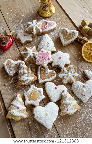 Homemade christmas cookies with decoration on wooden table