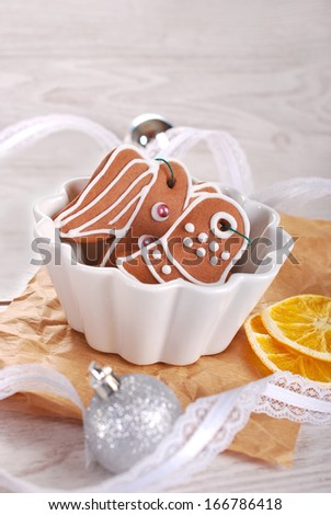 homemade christmas gingerbread cookies decorated with icing in white bowl - stock photo