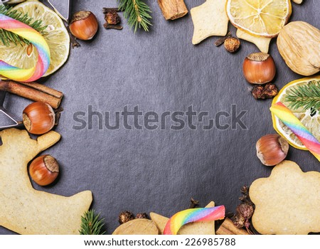 homemade Christmas gingerbread cookies on a black background. Space for text or congratulations - stock photo