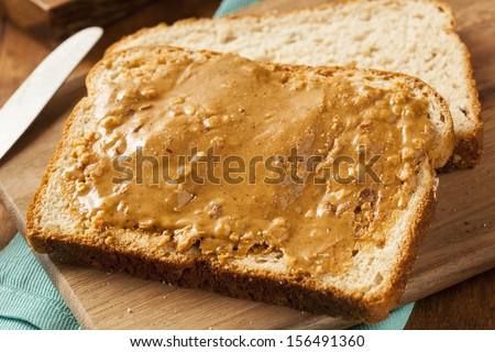 Homemade Chunky Peanut Butter Sandwich on Whole Wheat Bread - stock photo