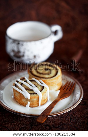 Homemade Cinnamon Roll pastry with cream cheese icing, selective focus - stock photo