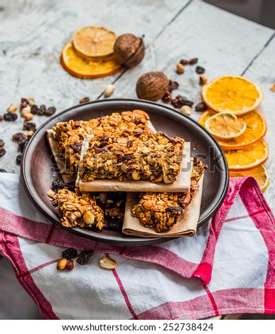 Homemade citrus granola protein bars with peanut butter, honey, oatmeal on wooden background - stock photo