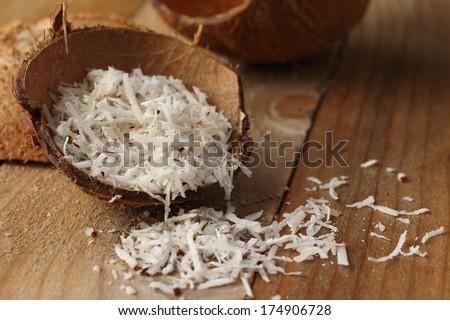Homemade coconut shavings in coconut shell - stock photo