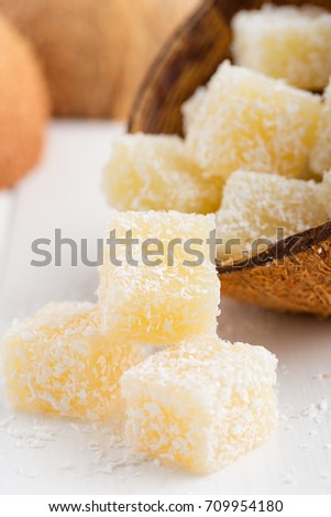 Homemade coconut turkish delights or rahat lokum on white background