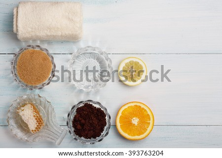Homemade coffee scrub with coconut oil, honey, sugar, orange, lemon - stock photo