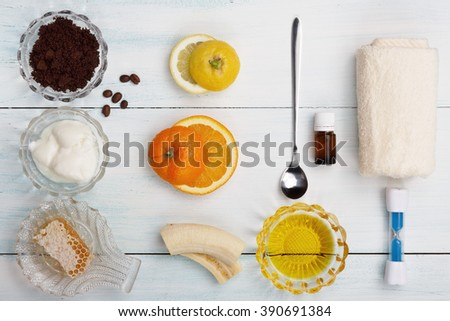 Homemade coffee scrub with grapeseed oil, sugar, yogurt, sea salt, orange, essence, lemon - stock photo