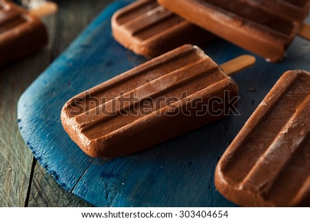 Homemade Cold Chocolate Fudge Popsicles on a Stick - stock photo