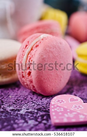 Homemade colorful macaroon with a light cream. Selective focus.