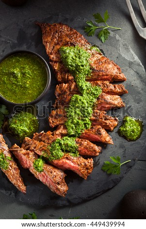 Homemade Cooked Skirt Steak with Chimichurri Sauce and Spices - stock photo