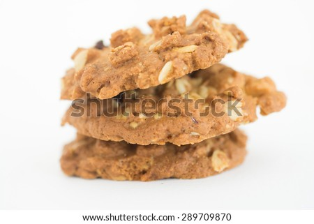 homemade cookie with oat flakes on white background. - stock photo