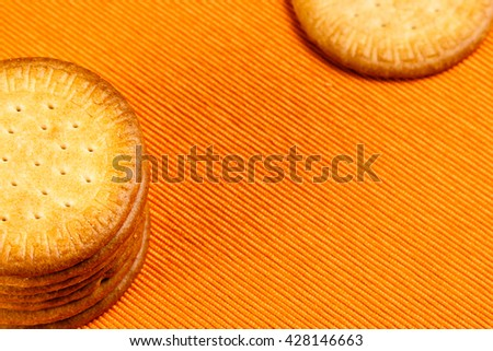 Homemade cookies on orange cloth background. Horizontal image.