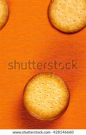 Homemade cookies on orange cloth background. Vertical image.