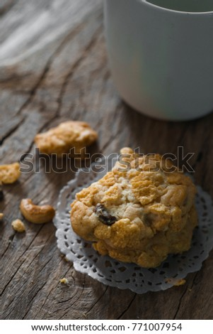 homemade cookies on plate,cereal and raisin cookies bakery on wood table