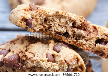 Homemade cookies with chocolate chips on an old gray wooden surface. Closeup