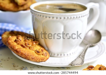 Homemade cookies with peanut and cup of coffee for a breakfast. - stock photo