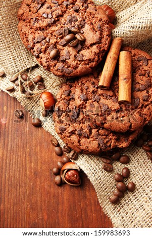 Homemade cookies with sesame seeds, chocolate, on wooden  table, on sackcloth background