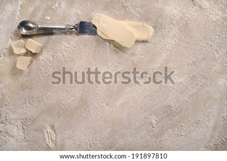 Homemade cooking setup. Customizable cooking recipe setup, homemade baking dough and some butter, top view.  - stock photo