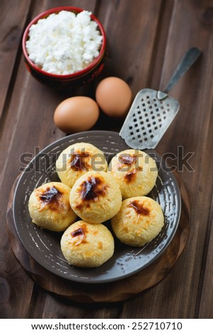 Homemade cottage cheese pancakes and ingredients, studio shot - stock photo