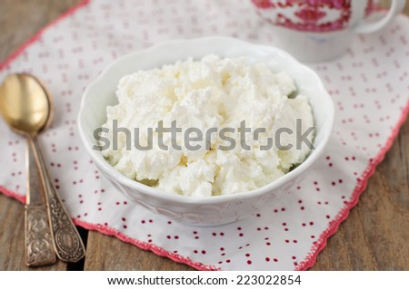 Homemade Cottage Cheese (Quark, Cream Cheese, Curd) in a White Bowl, Healthy Breakfast, copy space for your text - stock photo