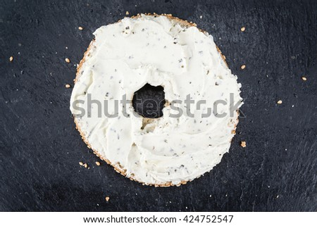 Homemade cream cheese Bagel (selective focus; close-up shot)