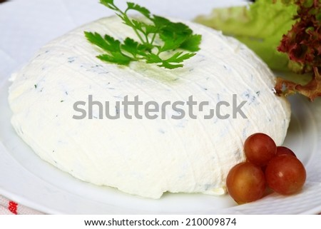 Homemade cream cheese with cut chives inside - stock photo
