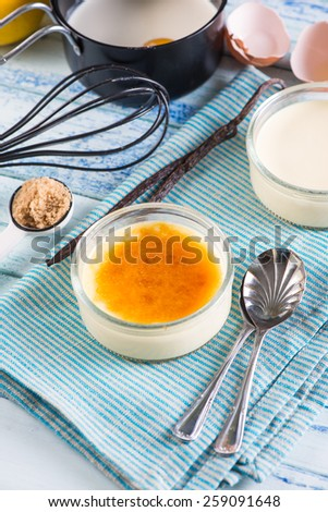 homemade creme brulee with ingredients - stock photo