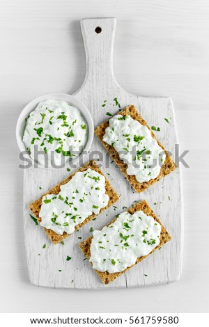 Homemade Crispbread Toast With Cottage Cheese And Parsley On White Wooden Board Background