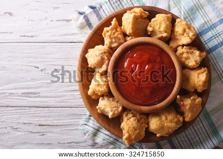 Homemade crispy popcorn chicken with barbecue sauce horizontal view from above  - stock photo