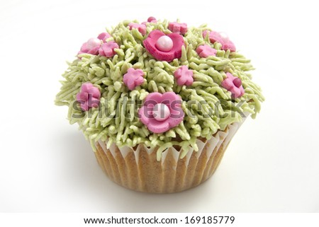 Homemade cupcake with grass and flowers frosting