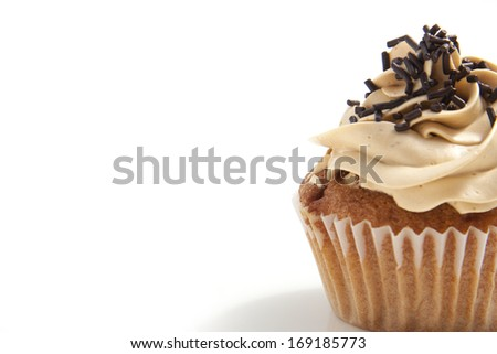 Homemade cupcake with toffee frosting and chocolate sprinkles