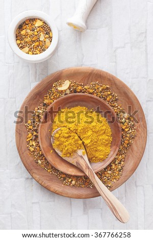 Homemade Curry Powder. Curry spices in a shallow bowl with a spoon. Top view, blank space, vintage toned image. Natural light - stock photo