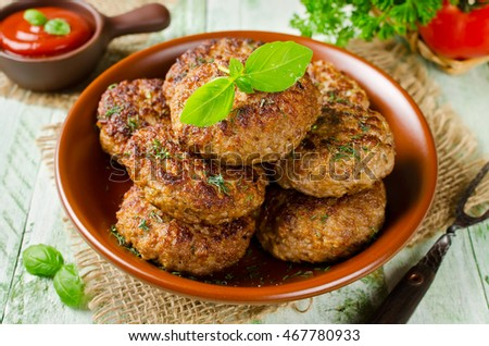 Homemade cutlets with oatmeal on a wooden table in a rustic style. Healthy food