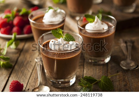 Homemade Dark Chocolate Mousse with Whipped Cream - stock photo