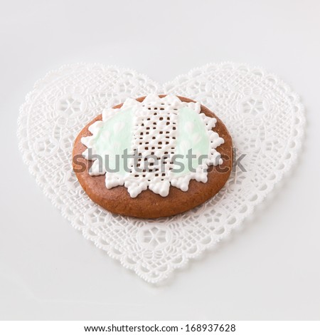 Homemade decorated round gingerbread cookie - stock photo