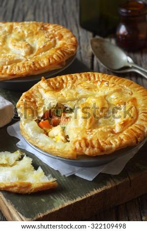 Homemade delicious chicken pies. Selective focus - stock photo