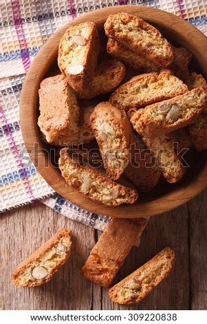 Homemade delicious cookies biscotti with almonds close-up on the table. Vertical top view - stock photo