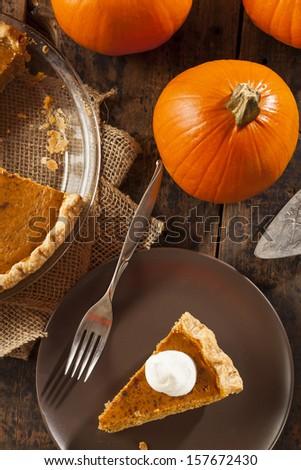 Homemade Delicious Pumpkin Pie made for Thanksgiving - stock photo