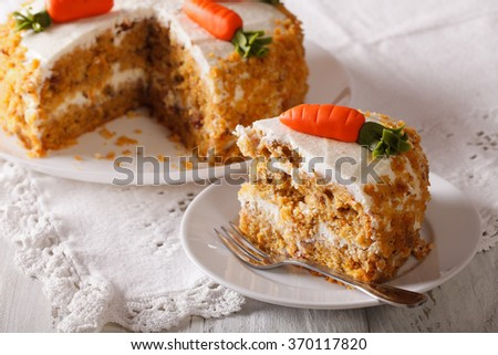 Homemade desserts: sliced carrot cake on a plate closeup. horizontal