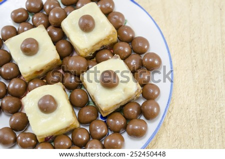 Homemade desserts with a chocolate ball on top - stock photo