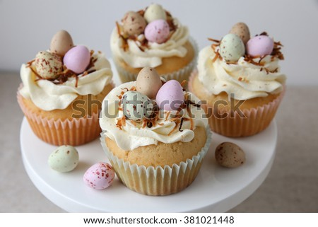 Homemade Easter eggs cupcakes - stock photo