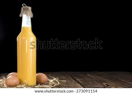 Homemade Egg Liqueur on dark vintage wooden background - stock photo