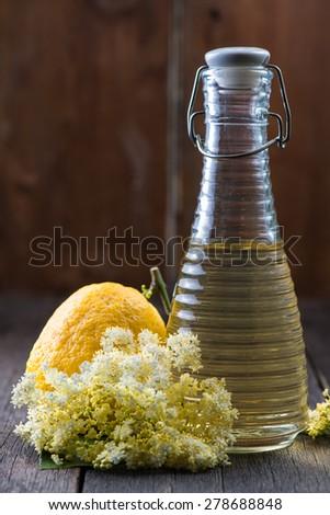 Homemade elderflower cordial on wooden background and fresh flowers ...