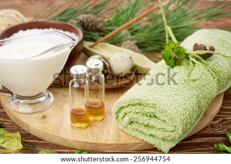 Homemade facial masks with natural ingredients, on color wooden background - stock photo